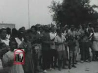WSB-TV newsfilm clip of African Americans demonstrating against segregation and reporter Tom Brokaw interviewing mayor T. Griffin Walker in Americus, Georgia, 1965 July 29