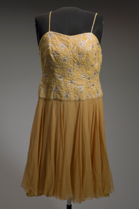 Yellow cocktail dress designed by Don Loper and worn by Ella Fitzgerald