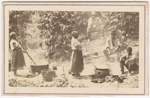 Carte-de-visite view of a group of men, women and boys standing or seated around boiling pots and tubs, Brazil, n.d