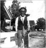 [Photograph of a man with a walking stick in or near Richmond County, Georgia, late 19th century]
