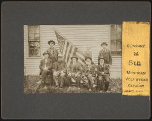 [Reunion of Co. M, 5th Michigan Cavalry Regiment veterans, in uniforms with American flag]