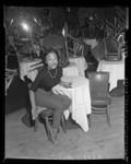 Singer Eartha Kitt, seated in empty nightclub in Los Angeles, Calif., 1953