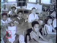 Series of WSB-TV newsfilm clips of an interracial classroom, interviews with Armand Duvio and Louise Tate, a reporter speaking about the influence of the Louisiana legislature, and outtakes from commentary on the school integration crisis in New Orleans, Louisiana, 1960 December