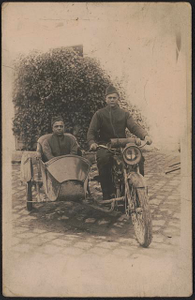 [Two unidentified African American soldiers in uniforms and overseas caps on motorcycle with sidecar]