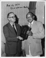 Claude Ramsay presenting plaque to Earl Davis, Jackson, Mississippi, August 13, 1977