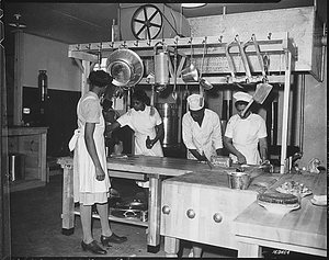 """""""...WAAC cooks prepare dinner for the first time in new kitchen at Fort Huachuca, Arizona."""""""