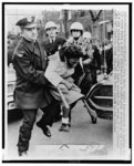 [Police struggle with African American female civil rights protester reacting to death of fellow demonstrator, minister Bruce Klunder, struck and killed on the scene by a bulldozer, Cleveland, Ohio]