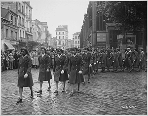 """""""Members of the 6888th Central Postal Directory Battalion take part in a parade ceremony in honor of Joan d'Arc at the marketplace where she was burned at the stake."""""""