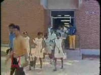 WSB-TV newsfilm clip of reporter Lo Jelks interviewing administrators and students about the possibility of merging two colleges, one historically white and one historically African American, in Savannah, Georgia, 1970 May 11