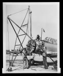 Maintenance Mechanics on the flight line remove an engine from a trainer plane for repair.