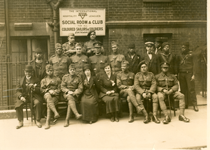 African American soldiers and sailors in front of YMCA Social Room & Club