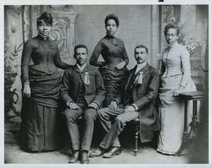 W. E. B. Du Bois seated with classmates from Fisk University