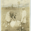 Black woman and girl in a South Carolina cotton field, tying a bundle