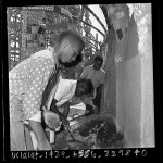 African American boys from Markham Junior High School gardening at Watts Towers, Los Angeles, Calif., 1965