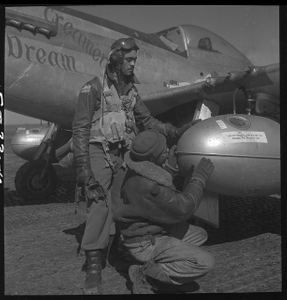"[Tuskegee airman Edward C. Gleed, Lawrence, KS, Class 42-K, with an unidentified crewman adjusting an external seventy-five gallon drop tank on the wing of a P-5/D, ""Creamer's Dream."" Ramitelli, Italy, March 1945]"
