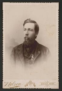 [Civil War veteran Alfred Colburn of Co. K, 1st Minnesota Infantry Regiment and 2nd Minnesota Light Artillery Battery with medal]