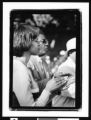 African American woman clapping, Los Angeles, 1999