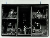 Residents gather outside on their balconies, June 20, 1993