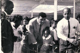 Photograph of Muhammad Ali and Theron Goynes at Highland Elementary School, November 4, 1965