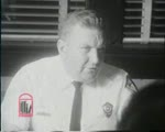WALB newsfilm of police chief Laurie Pritchett speaking to reporters from his office about the outbreak of violence following the arrest of demonstrators at a night march in Albany, Georgia, 1962 July 24