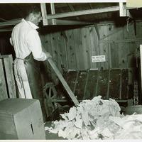 Black employee collecting scrap salvage Original ID: 6.603-22776