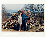 Lisa, Tom, Baba, and Pilar Law by wood pile at the foot of the Sangre de Cristo Mountains. Truchas, NM. 1970