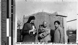 Maryknoll Sister with family, Fushun, China, 1939