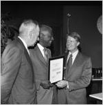 Governor Jimmy Carter presenting Dr. Benjamin E. Mays with the Outstanding Older Georgian Award, Morehouse College, Atlanta, Georgia, August 6, 1971