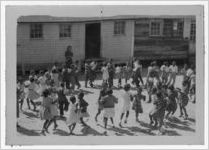 Photograph of African American schoolchildren square dancing, Manchester, Georgia, 1953