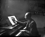 [Thomas Kerr at piano : black-and-white photonegative.]