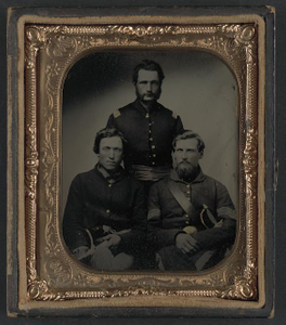 [Three unidentified soldiers, probably of Company B, 23rd Ohio Infantry Regiment, with revolvers and sword]