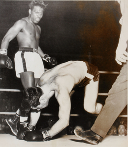 Sugar Ray Robinson (standing) sparring with Ted Olla in ring, Milwaukee, Wisconsin