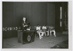 Cuban anthropologist Fernando Ortiz lecturing on Afro-Cuban music, assisted by three Black Cuban drummers playing batá drums, before a White audience in Havana, Cuba, on May 30, 1937