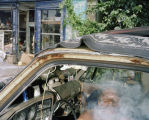 Man Smokes in His Car