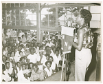 [WANN broadcast of Sarah Vaughan at Carr's Beach, August, 1956, with fans standing attentively while she sings.] [Black-and-white photoprint]