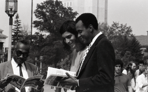 Bill Grabin showing Free Spirit Press magazine to African American faculty members in front of the UMass Amherst Student Union