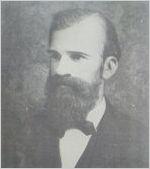 A black and white image of Bernard Mallon, Massie School's first principal