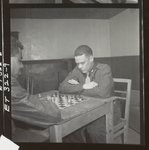 [Officers in 332nd Fighter Group playing chess in officers' club at air base in southern Italy]