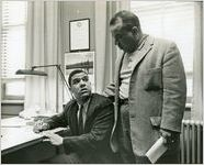 Hamilton E. Holmes, one of the first two African-American students to integrate the University of Georgia (seated), with his father Alfred Holmes, Athens, Georgia, January 9, 1961
