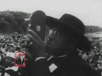 WSB-TV newsfilm clip of African American civil rights leaders including congressman Adam Clayton Powell and Dr. Martin Luther King, Jr. speaking at the Prayer Pilgrimage for Freedom, Washington, D.C., 1957 May 17