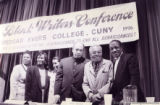 Walter Mosley and other panelists posing for photographs