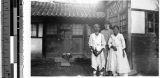 Sister Edwardine, MM, standing with an elderly Korean couple, Heijo, Korea, October 1938