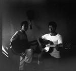 Atsushi Ishida and Takashi Ishida playing guitar