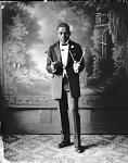 W. A. Sullivan [full length, holding mallets] [acetate film photonegative]