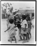 [Children appealing to Walter F. White for handouts, on a military base somewhere in the Pacific]