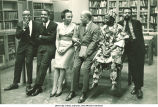 Members of Black Writers panel chatting, Countee Cullen Branch of New York Public Library, New York, N.Y., May 1963