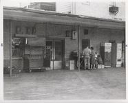 Mississippi State Sovereignty Commission photograph of a male and female standing near the rear entrance to Stanley's Cafe, Winona, Mississippi, 1961 November 1