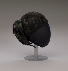 Black hat with iridescent black feathers from Mae's Millinery Shop