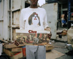 """A Man Holding His """"Clue"""" Board Game"""