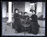 Group. Ellie & Anna Rhoads, Bessie & Sam [Porch of Deshler-Morris House, 5442 Germantown Avenue]